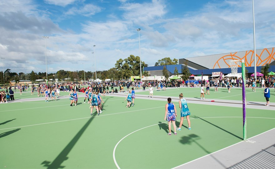 Netball players on outside courts at the State Netball Centre.jpg