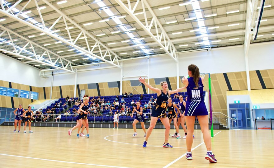 Netball players on the indoor courts at the State Netball Centre.jpg